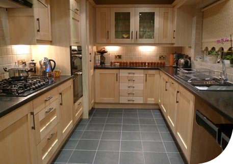 Photo of Mr and Mrs Fuller completed kitchen